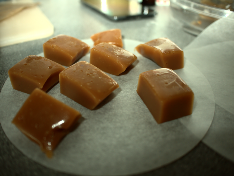 Salted caramels, carefully placed on non-stick paper.